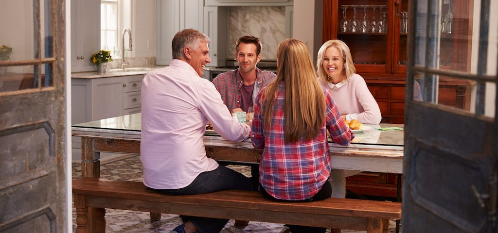 Family having a discussion around a table
