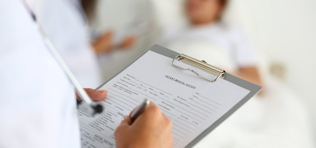 Doctor filling out report